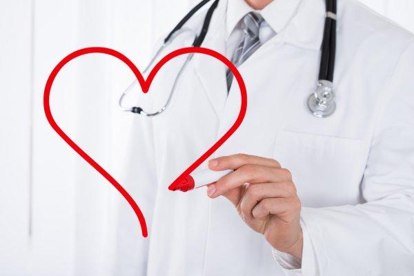 depositphotos_108388116-stock-photo-doctor-drawing-heart-symbol